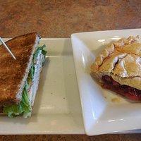 Half turkey sandwich with cherry pie