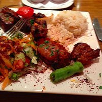 Salad, rice with pine nuts, lamb shishkebab with lots of Turkish pepper decorating the plate