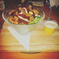 Barbeque Chicken Wings on a bed of Salad with blue cheese dressing
