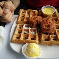 Fried chicken with sweet potato waffles, with orange flavoured butter and honey mustard