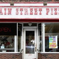 Front of Main Street Pizza in Manistique, MI on Cedar Street