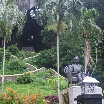 The statue of HM The King's mother, with the cave in the background