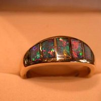 Black Crystal Opal ring in 14K Gold. Handmade by Australian Opal Company sold at wholesale price