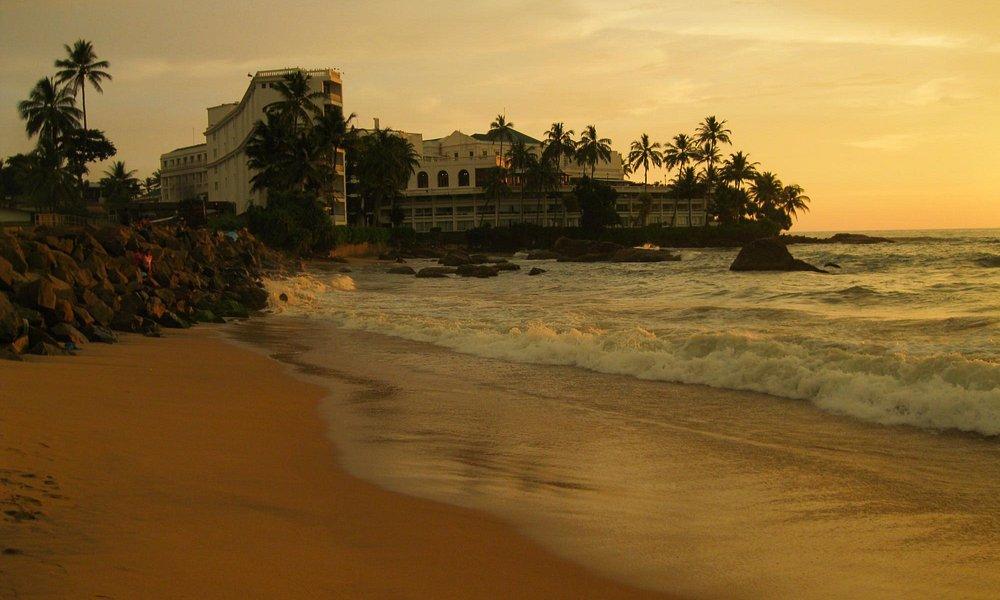 Mount Lavinia Hotel and the beach, during a sundown.