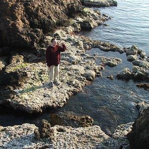 Exploring a rock pool at Playa de Percheles