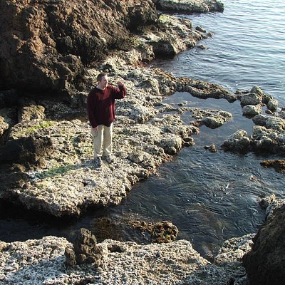 Exploring a rock pool at Playa de Percheles