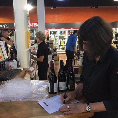 Ms Denise writing up a note that we did not take any wines for the charge she made on our card
