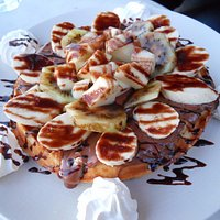 Waffle with fruits and whipped cream