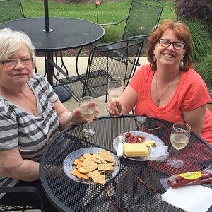 Lovely ladies enjoying some wine outdoors