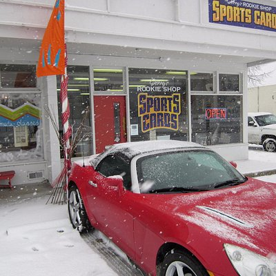 Exterior of shop on a snowy day.
