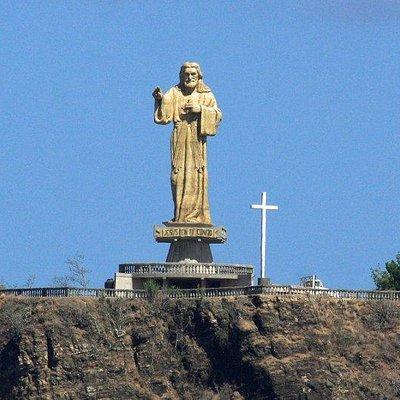 Visit the statue of El Cristo de la Misericordia and hear the story behind it