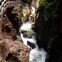 Trail beside rushing water