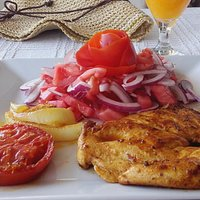 grilled chicken and chips and salad