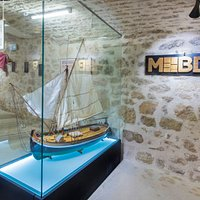 Entrance to the museum. The scale model of bracera.