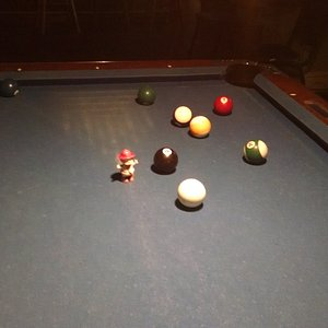 Our friend Tommy playing pool at O'Shaughnessy's Pub.