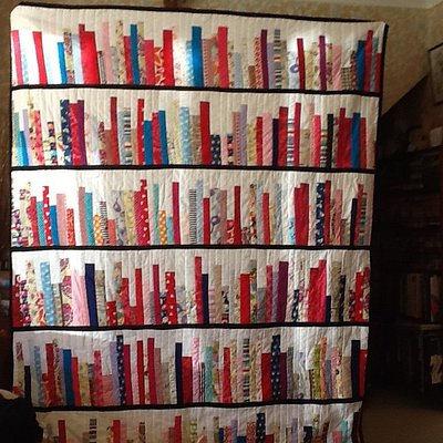 A quilt that looks like a book case. All fabrics from owl and sewing cat