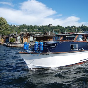 Candere cruising by floating homes on Lake Union