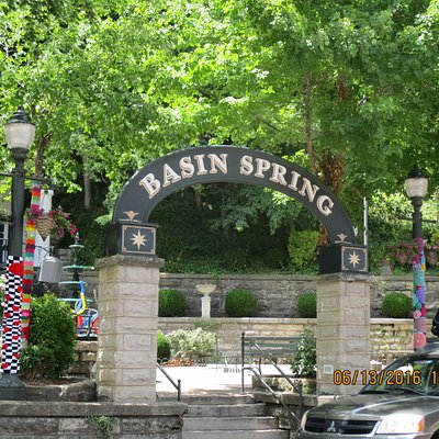 Center of historic district containing many shaded benches and views of the spring