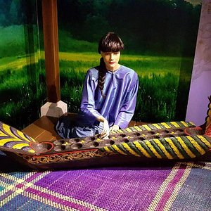 """a diorama of a lady playing """"Congkak"""", a traditional game"""