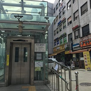 the entrance of the hotel is just behind the elevator at Exit 2 of Sinseoldong Station