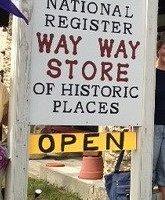 Store road sign greeting visitors