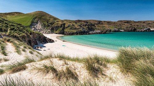 The sandy bay beyond Carnish