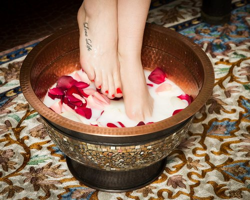 Feet bath with rose petals and milk