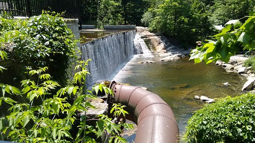 View of the dam, and remains of the penstock which fed the turbine