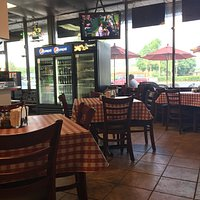 Interior and outside seating at Boardwalk Pizza.