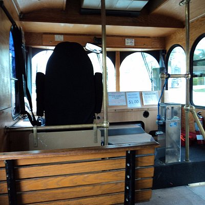 Inside the Trolley in back of the driver.