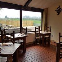 Dining facing outdoor seating