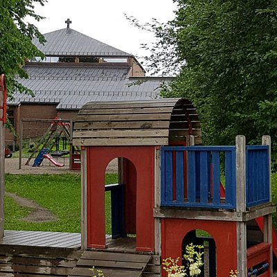 The church kindergarden playground with the church behind.