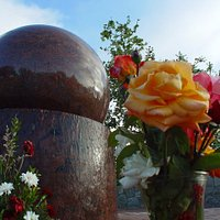 Looking up at the Floating Granite Ball with flowers to the memory of the Roy Wilson Jr. 2007