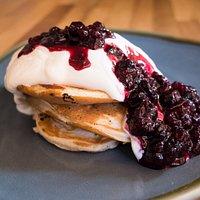Blueberry Pancakes (v) fresh American style pancakes topped with yoghurt & berries (v)