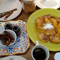 Baked french toast with peaches and Vermont maple syrup and sausages