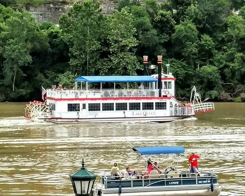 A riverboat and a fishing boat sailed by as we sat outdoors having lunch.