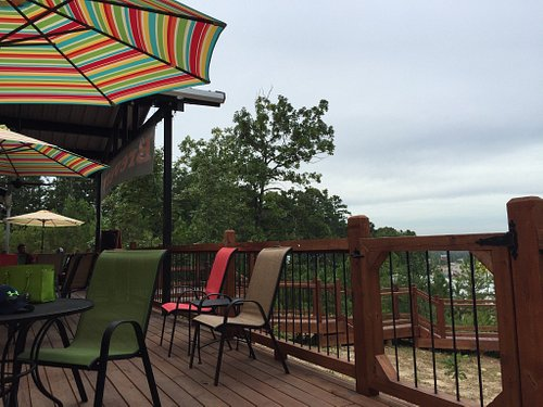 The brewery is high on a hill overlooking trees & 259 near Girls Gone Wine & Grateful Head Pizza