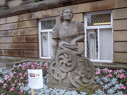 Stone Statue of Woman Left of Front Steps