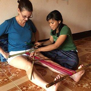 The beautiful Mone teaching Caroline how to use a traditional Katu loom