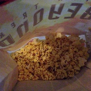Notice the five pieces of normal sized popcorn remaining in the bag.