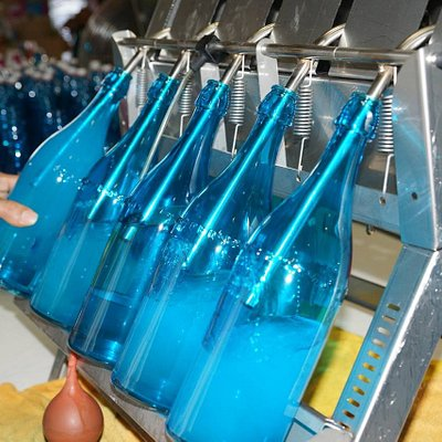 Rhum filling the Blue Bottles!