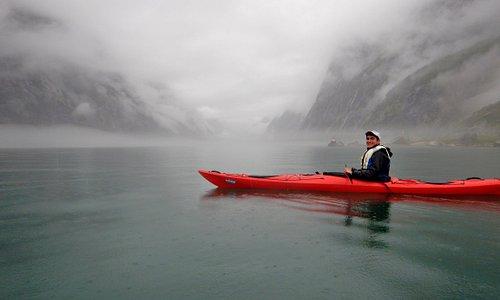 Kayaking to the base of the Kjerag bigwalls
