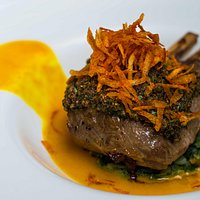 Crusted Lamb rack with spinach and potato , coconut sauce