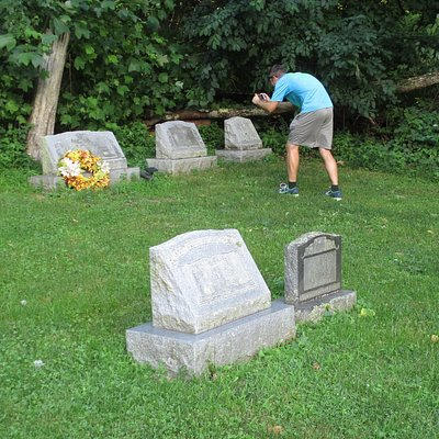 My son taking photos of tombstones