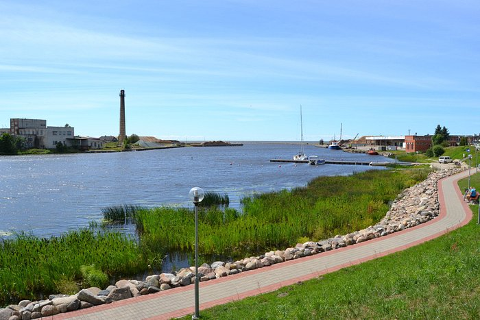 The promende area at the mouth of the Salaca River with a path for walking and benches