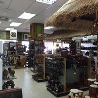 Bottom floor of Jack's with a large selection of wood carvings