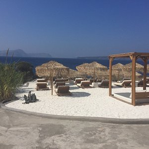 Beautiful chairs and umbrellas at The Beach, Akrotiri and an amazing view to the Caldera.