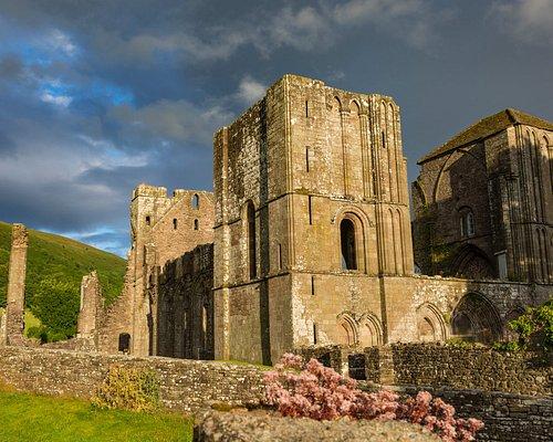 The low evening sun illuminates the priory