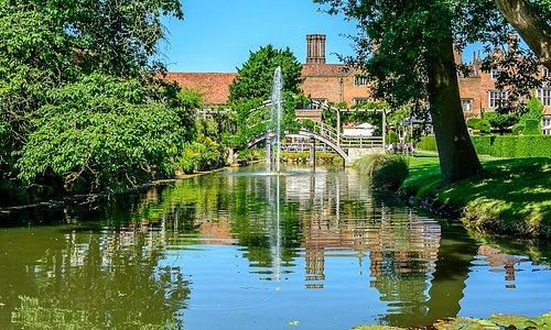 Great Fosters in the summer across the saxon moat