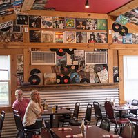 Walls and ceilings are plastered with LPs, 45s, and musical instruments.